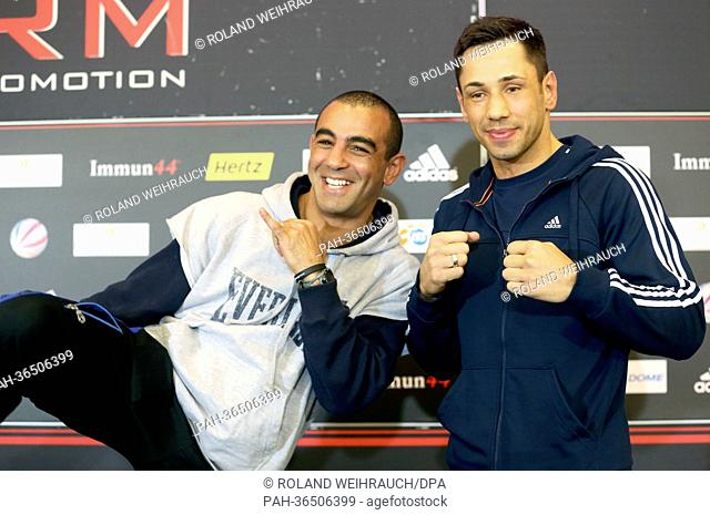 Middleweight boxers Germany's Felix Sturm (R) and Australia's Sam Soliman pose during a press conference in Duesseldorf, Germany, 28 January 2013