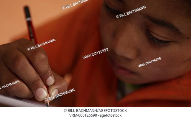 Kathmandu Nepal child draws in art class at childrens home in Eastern Kathmandu, Nepal