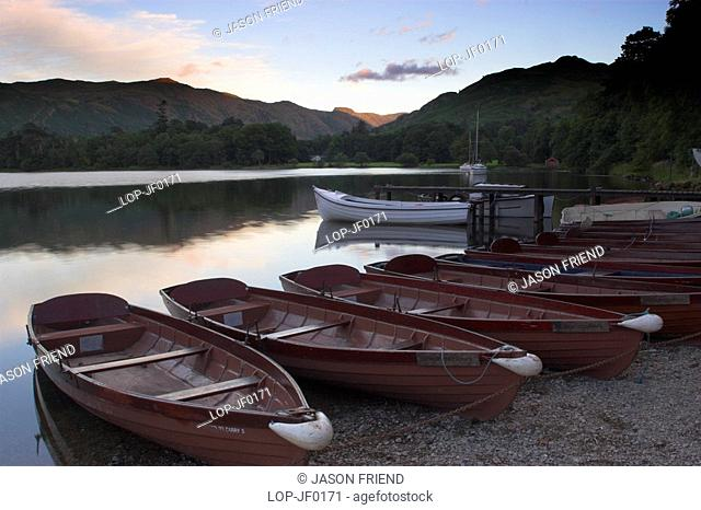 England, Cumbria, Ullswater, Rowing boats and the sweeping vista of Ullswater which is part of the Lake District National Park