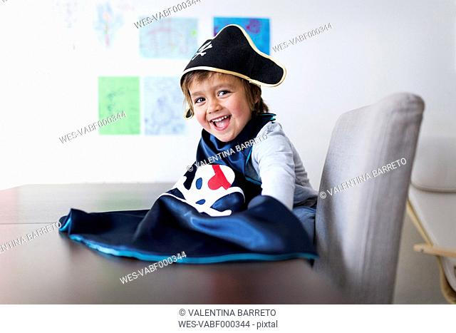 Portrait of laughing little boy dressed up as a pirat