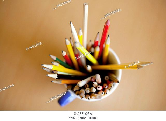 Directly above shot of pencils in desk organizer on table