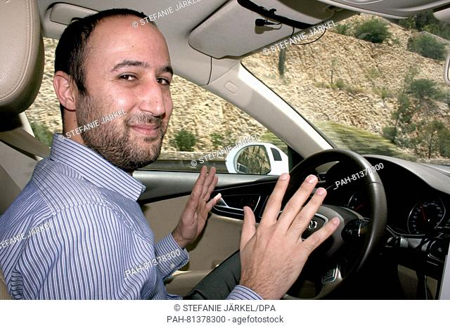 "Nir Gideon, development expert at the company Mobileye in Jerusalem, drives around inside an """"autonomous Audi"""" near Jerusalem, Israel, 09 May 2016"