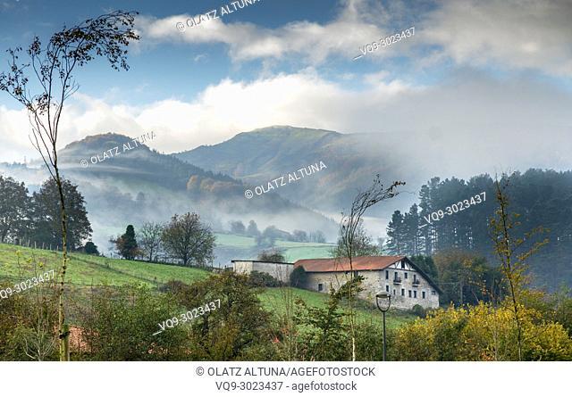 Farmhouse on foggy autumn morning in Loiola, Azpeitia, Gipuzkoa, Basque Country, Spain