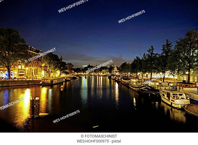 Netherlands, North Holland, Amsterdam, Amstel river at night