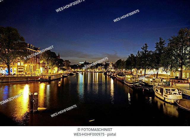 Netherlands, North Holland, Amsterdam, Amstel river at night