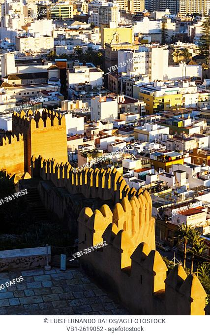Old town overview and Alcazaba castle walls at sunset. Almeria, Spain