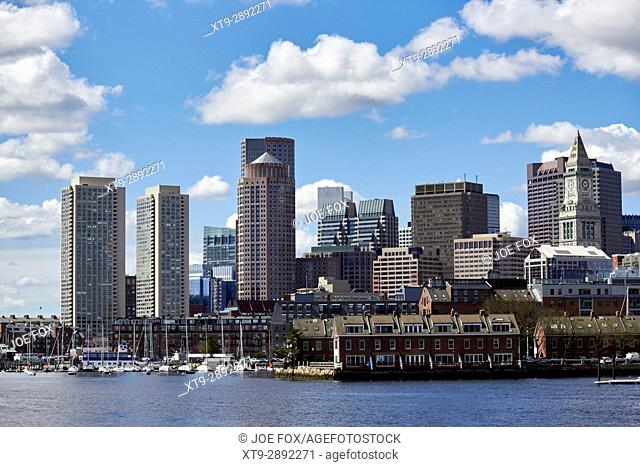 view over riverfront and wharves towards city centre financial district Boston USA
