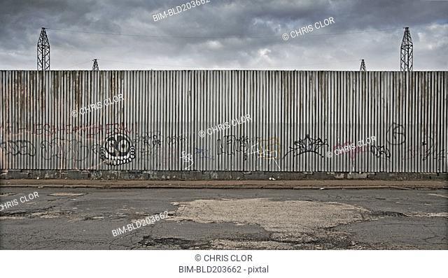 Graffiti on urban metal wall