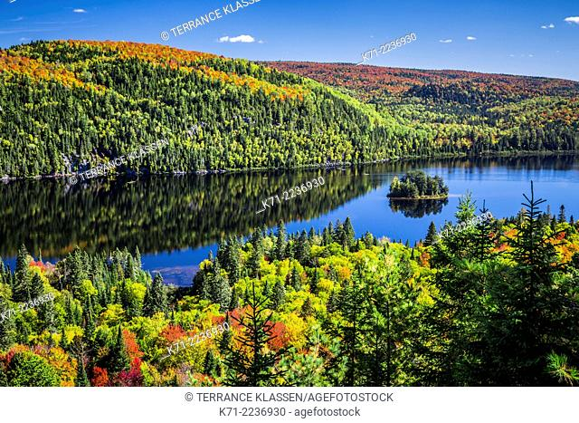Brilliant fall foliage reflections in La Maurice National Park, Quebec, Canada