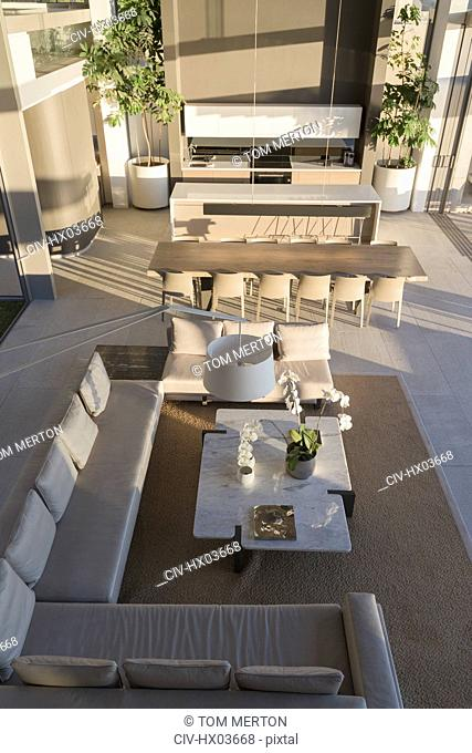 Elevated view luxury, modern home showcase interior living room and dining room
