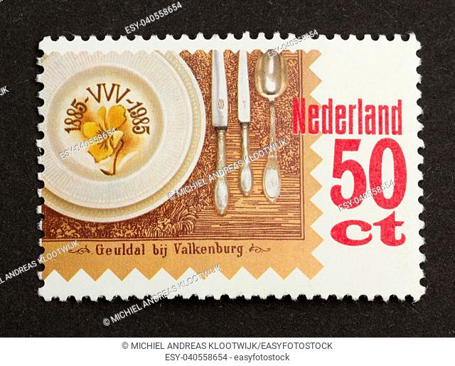 HOLLAND - CIRCA 1980: Stamp printed in the Netherlands shows a plate, knives and a spoon, circa 1980