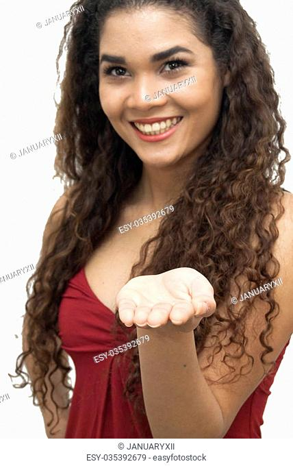 Beautiful latin girl with open hand over white background