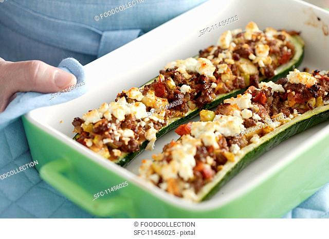 Stuffed, gratinated courgettes