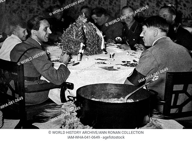 Adolf Hitler arriving at meal in the Chancellery, accompanied by Dr Josef Goebbels