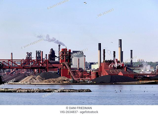 The Hamilton Steel Mills spew pollutants from their smoke stacks along Lake Ontario. With sixty percent of Canada's steel being produced in Hamilton by Stelco...