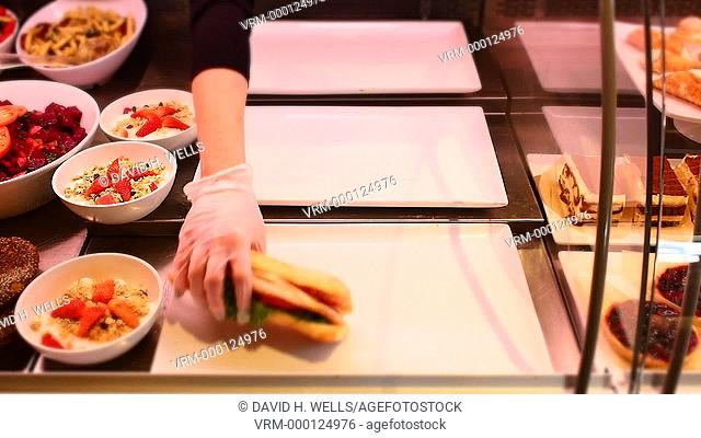 Sandwiches being stacked in a Cafe' in Providence, Rhode Island
