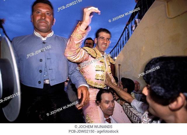 jerez de la frontera, torero padilla leaves the arena on the shoulders through the main gate