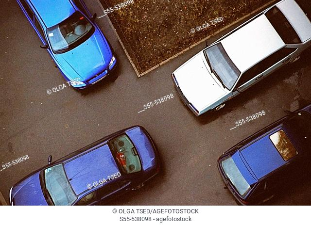 View of four cars taken from the 11th floor at one nasty day. St.-Petersburg, Russia