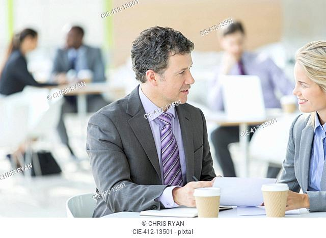 Business people talking at cafe