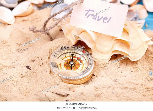 Compass in the sand with Message - Travel