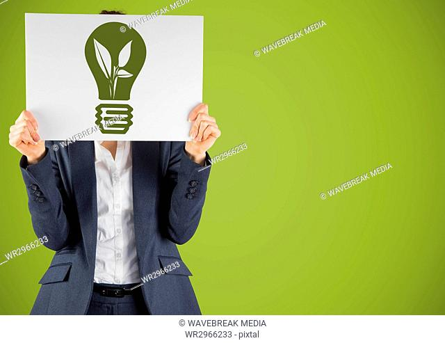 Business woman with card over face and green lightbulb graphic against green background