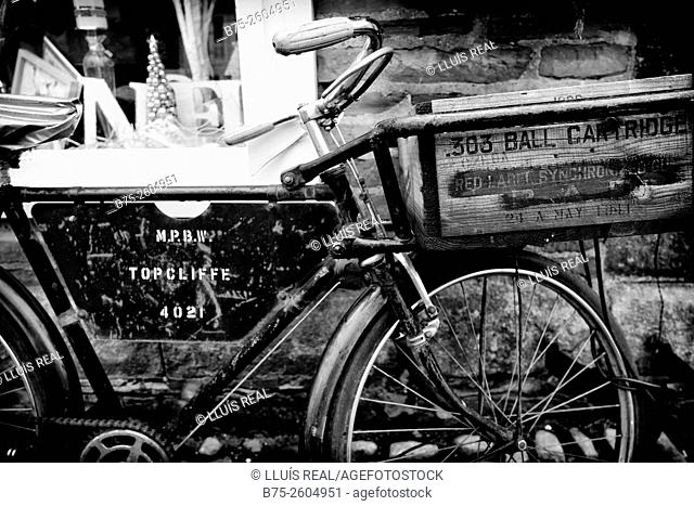 Close up of an old vintage bicycle parked on a facade of a shop in Grassington, Skipton, North Yorkshire, Yorkshire Dales, England, UK, Europe