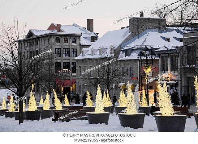 Old architectural buildings at Place Jacques Cartier in winter at dusk, Old Montreal, Quebec, Canada
