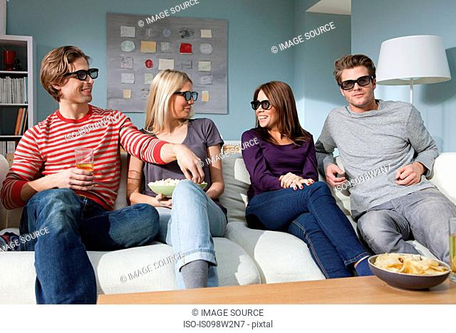 Four friends watching 3d movie at home