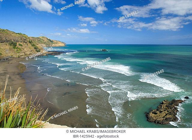 Waves rolling on the black beach of Maori Bay, Muriwai Regional Park, Auckland, North Island, New Zealand