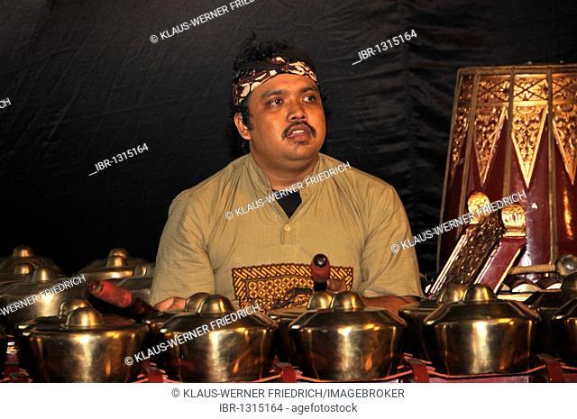 Gamelan musician playing on a Metallophone in Yogyakarta, Central Java, Java, Indonesia, Southeast Asia, Asia