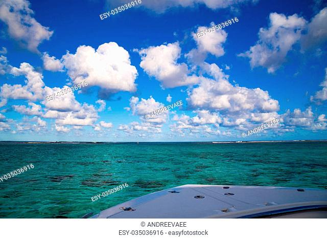 view from the boat on the Indian Ocean near the coast with korllami Mauritius and vnebe key light clouds float