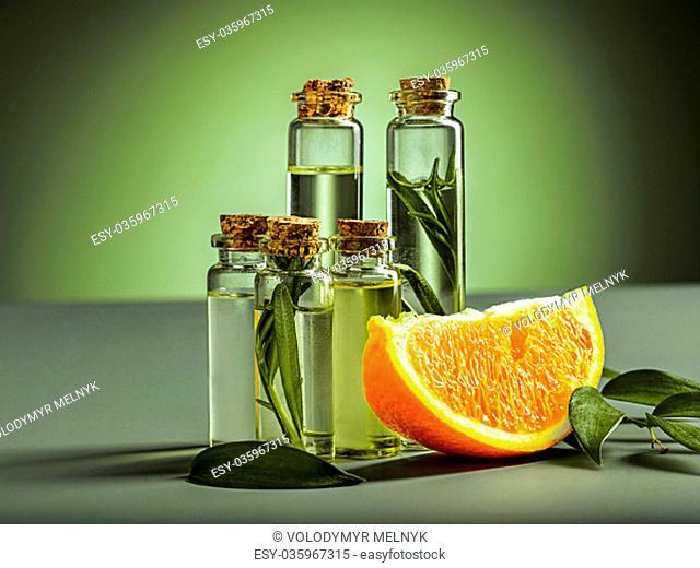 The oranges oil from orange on green studio background
