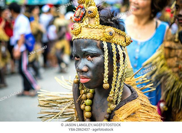 Kalibo, Aklan, Western Visayas, Philippines. A participant in the Ati-atihan festival wearing hand-made costume made from natural materials
