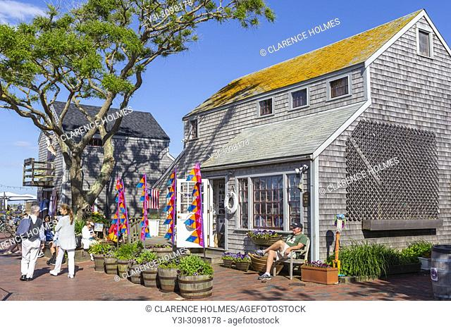 Tourists and visitors shop and stroll along Straight Wharf in Nantucket, Massachusetts