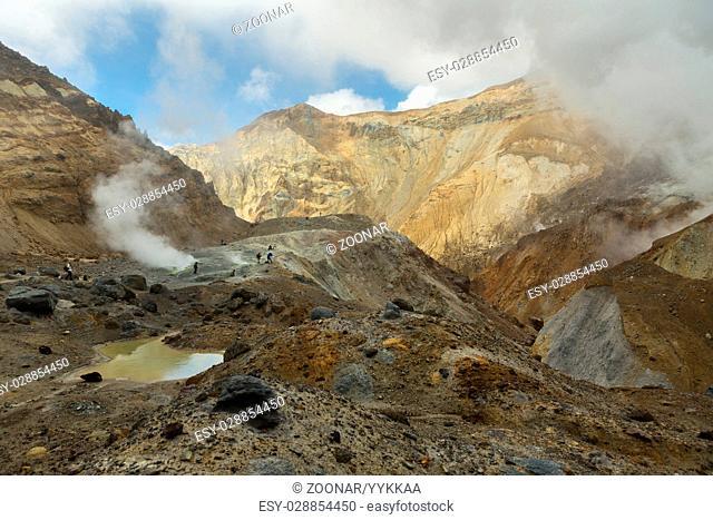 Climbing to active volcano Mutnovsky on Kamchatka