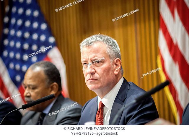 New York Mayor Bill de Blasio with other high-ranking members of the NYPD brief the media at their monthly press conference on October crime statistics at One...