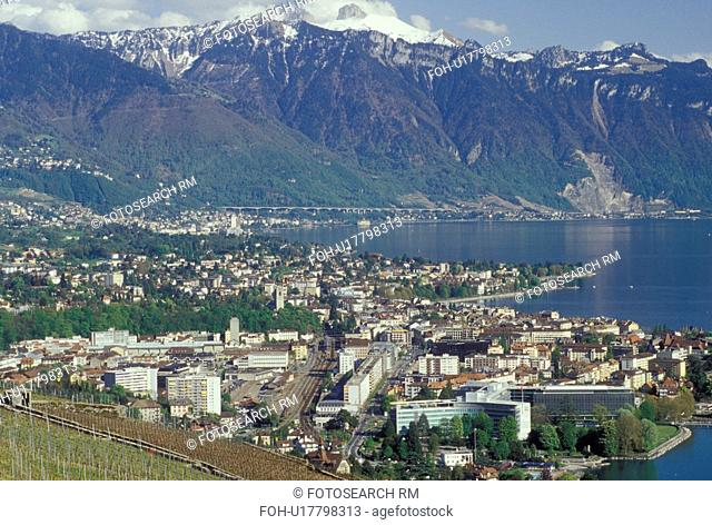 Switzerland, Vevey, Vaud, Lavaux, Lake Geneva, Alps, Europe, Scenic view of the city of Vevey and the Alps along the lakeshore of Lac Leman in the spring in the...