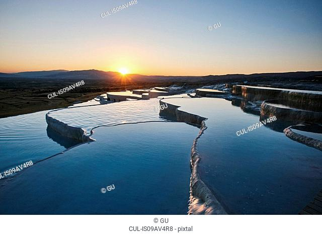 Hot spring terraces at sunset, Pamukkale, Anatolia, Turkey