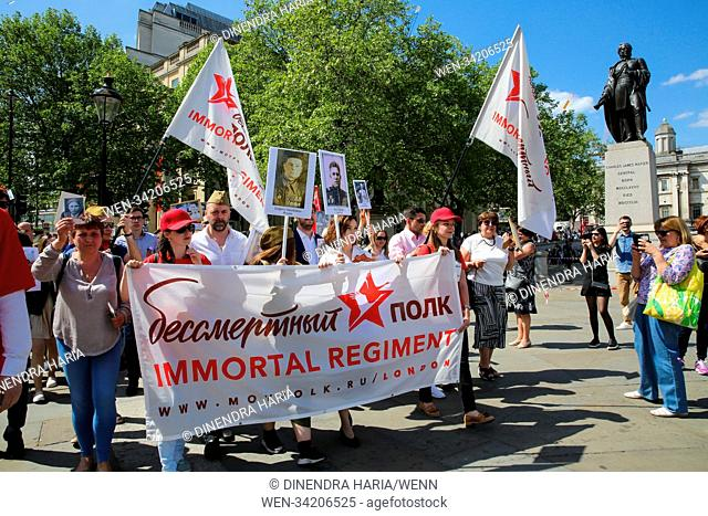 Hundreds gathered in Trafalgar Square and march via Whitehall, Big Ben, Houses of Parliament and Westminster Abbey in the Immortal Regiment parade