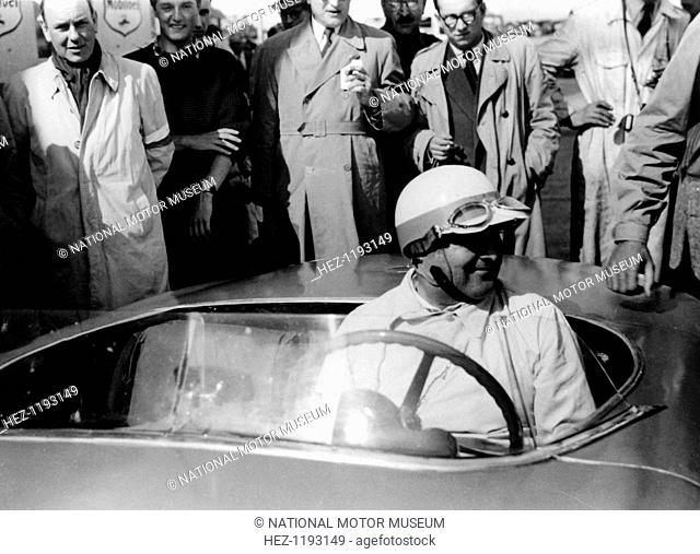 Hermann Lang in a Mercedes Benz 300 SL, Nurburgring 1000km, 1952. He first started racing motorcycle sidecars. In 1933 he joined the engineering division of...
