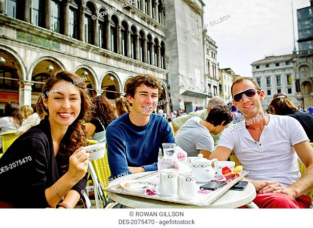 Friends Enjoying Coffee On Saint Mark's Square, Venice Italy