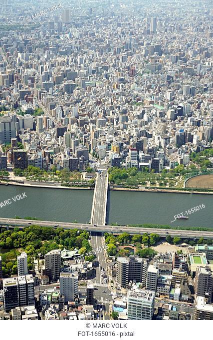 Aerial view of bridge over river in city, Tokyo, Japan