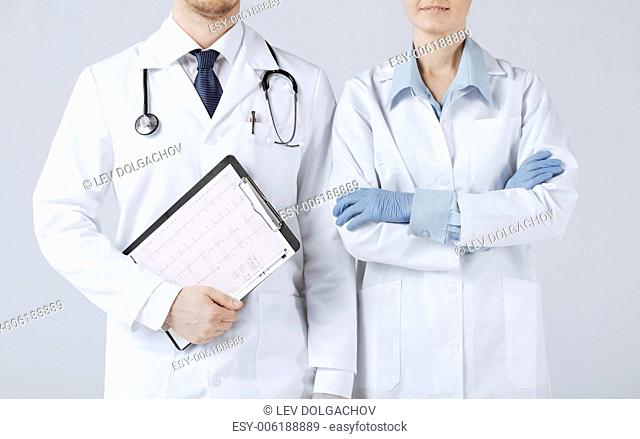 picture of nurse and male doctor holding cardiogram
