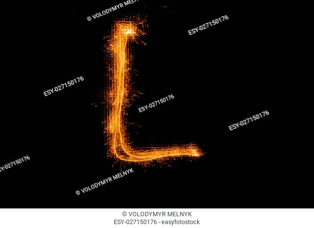 The English letter L made of sparklers on black background