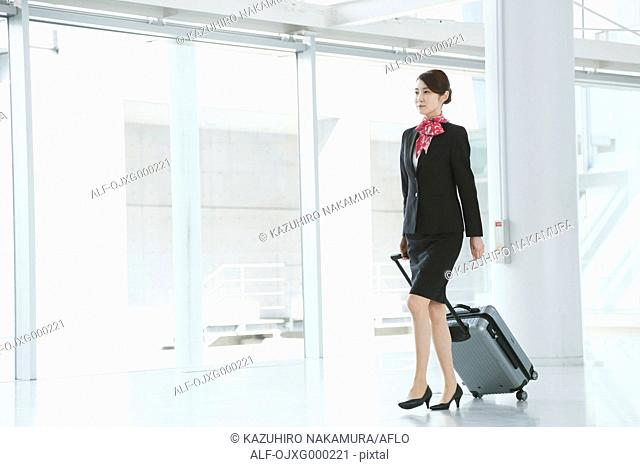 Japanese attractive flight attendant at the airport