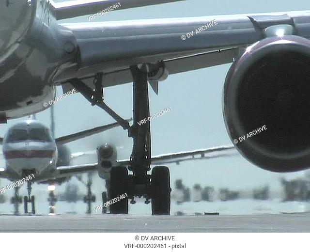 Airplanes taxi on a runway