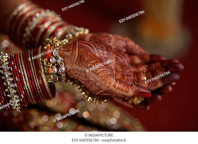 Bride's hands covered with henna