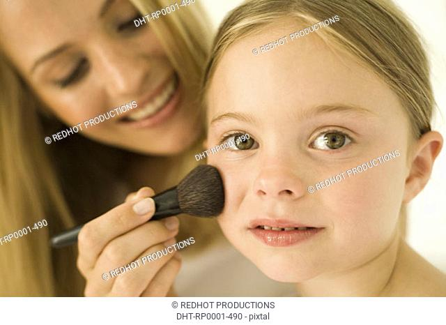 Mother and daughter with makeup