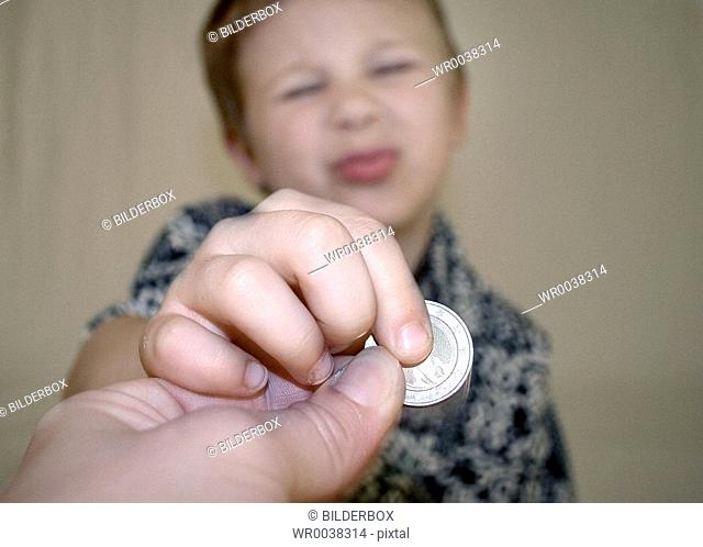 boy with a coin