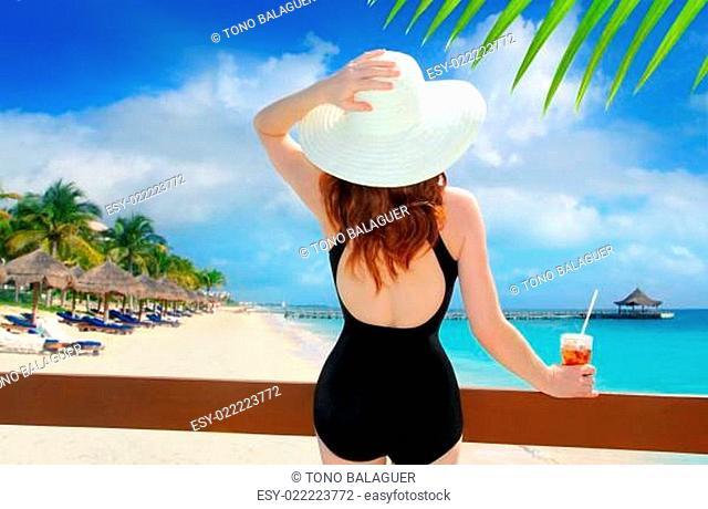 beach hat rear view woman cocktail tropical beach